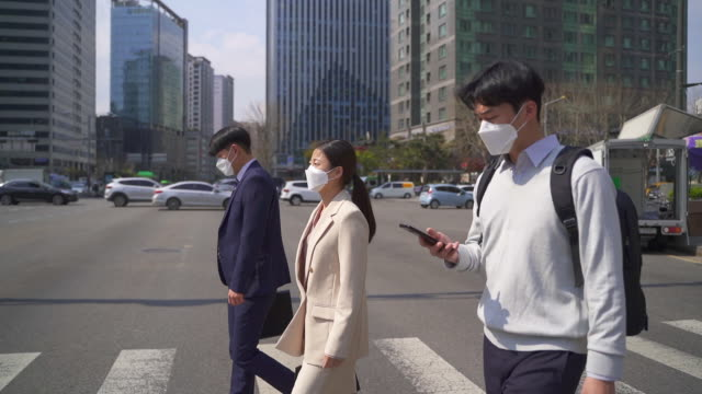 office workers commuting while wearing a protective mask to prevent the spread of covid-19 / seoul, south korea - shirt and tie stock videos & royalty-free footage