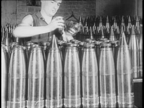 office workers type at typewriters / women work switchboards / a large industrial plant / montage of workers in an ammunition plant handling large... - ammunition stock videos & royalty-free footage