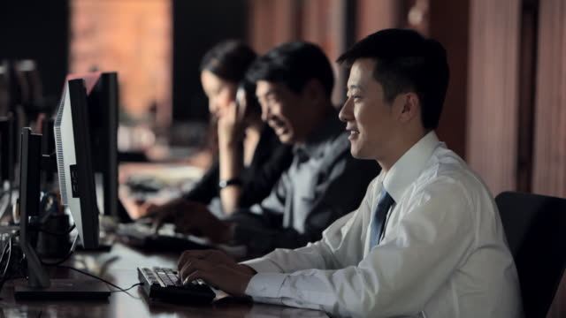 MS Office workers typing in office / China
