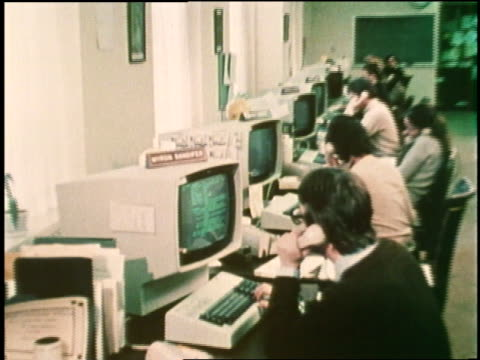 office workers use computers and talk on telephones. - 1970 stock videos & royalty-free footage