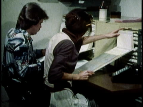 1979 montage office workers using paper documents to record information / united states - 1979 stock videos & royalty-free footage