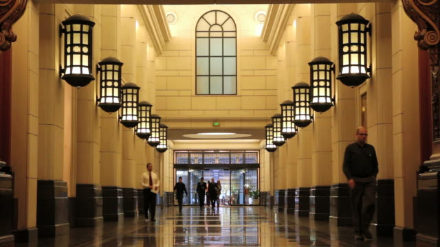ms slo mo office workers walking in lobby of office building / melbourne, victoria, australia - lobby stock videos & royalty-free footage