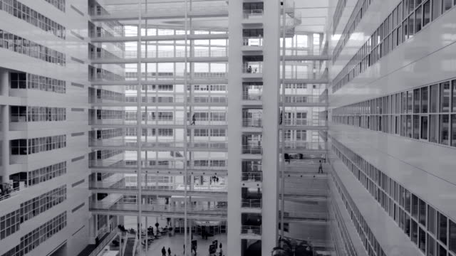 office workers walking on elevated walkway - the hague stock videos and b-roll footage