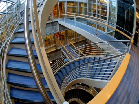 t/l office workers walking up and down stairs in dnv office, usa - puzzle video stock e b–roll