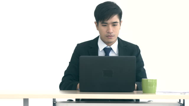 Office : Young Businessman Working on a Laptop