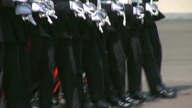 officer cadets at sandhurst mark milestone in military careers; england: berkshire: sandhurst: rma sandhurst: ext **parade band playing sot** parade... - 士官候補生点の映像素材/bロール