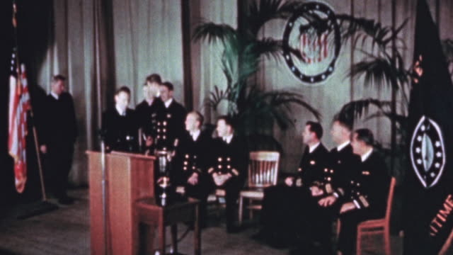 officer candidates from the us maritime service officer training school at graduation revealing the gold band on their sleeves denoting their... - 終わり点の映像素材/bロール