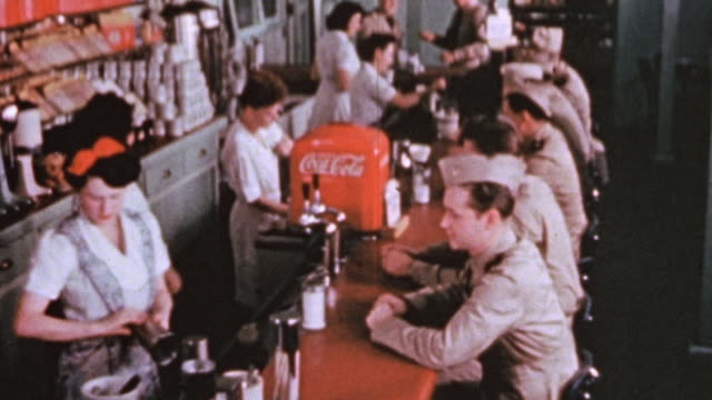 vídeos de stock, filmes e b-roll de officer candidates sitting and chatting at the counter of a diner / alameda california united states - lanchonete