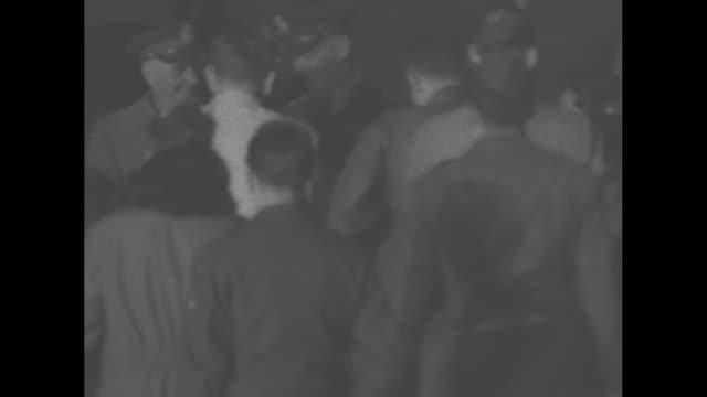 officer comes down steps from plane behind general james van fleet, newly appointed commander of us 8th army, as he arrives in tokyo / group of... - vangen bildbanksvideor och videomaterial från bakom kulisserna