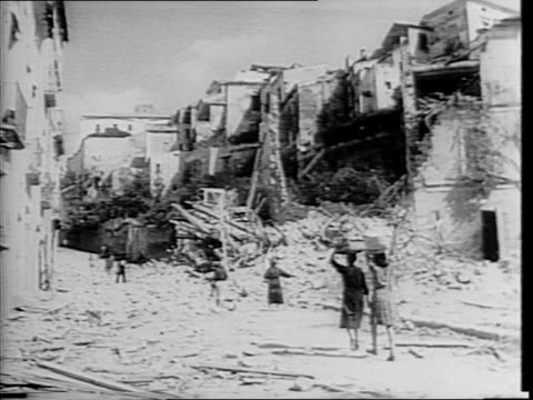 officer inspects camouflaged, wrecked tank / cannons fire repeatedly, close-ups / explosions in the distance / wrecked tanks / montage of allied... - hängen stock-videos und b-roll-filmmaterial