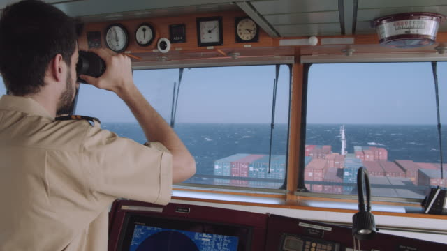 officer is checking the route with binoculars - radar stock videos & royalty-free footage