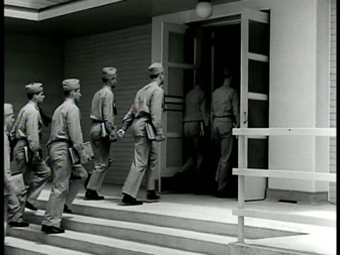stockvideo's en b-roll-footage met officer pilots in training marching to class ms cadets entering school building int vs naval instructor w/ model fighter airplane talking to... - 1942
