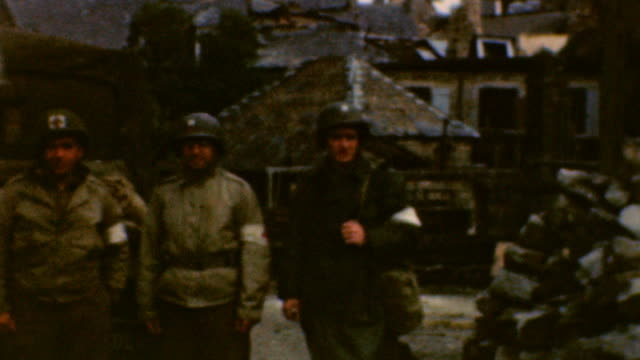officer pose in the ruins of cherbourg / jeeps drive past destroyed homes / close up of debris / medics from 237 combat engineers / d-day devastation... - 1944 bildbanksvideor och videomaterial från bakom kulisserna