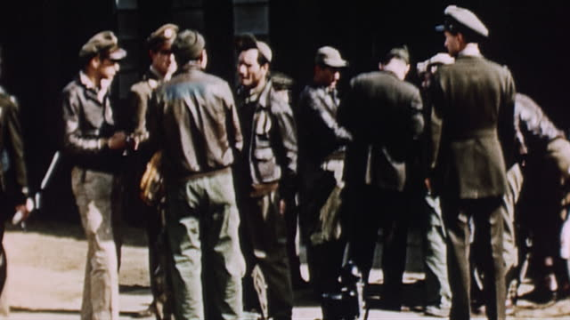 usaaf officer riding motorcycle past flightline flight crew standing and talking in front of ops building and flight crew unloading carryalls from... - us airforce stock videos & royalty-free footage