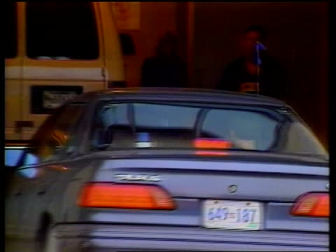 officer spy charge; itn usa: virginia: alexandria: car bringing harold nicholson along r-l into court parking area - spion stock-videos und b-roll-filmmaterial