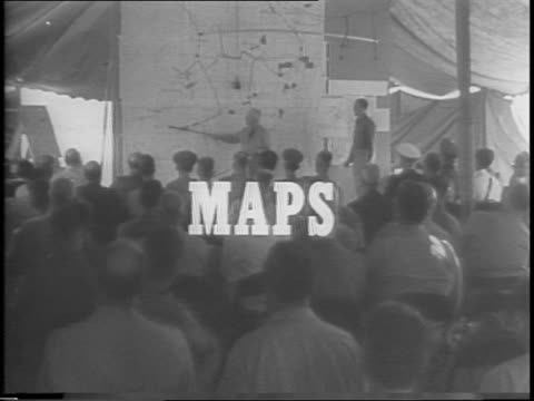 officer stands with large wall map in front of crowd of military personnel / montage of different soldier groups consulting maps / a row of people at... - tracing stock videos and b-roll footage