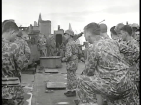 officer & us marines in camouflage uniforms in meeting on deck. tarawa topography map on riser. officer w/ pointer talking to marines seated around... - camouflage stock videos & royalty-free footage