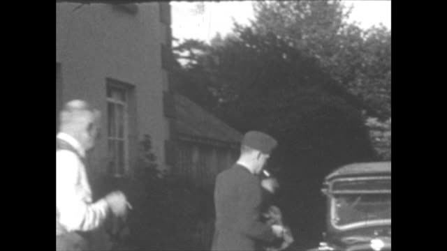 raf officer with older man officer walks car gets into it and drives off down driveway – car has one working headlight which is covered with a hood... - world war ii stock videos & royalty-free footage