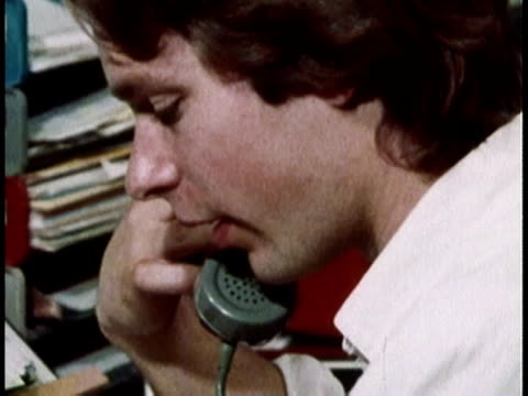 1979 montage officer worker ordering inventory over the phone / united states - addierrolle stock-videos und b-roll-filmmaterial