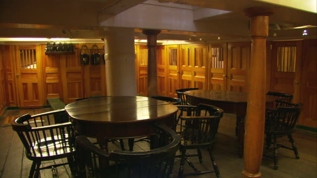 stockvideo's en b-roll-footage met ws pan cu officer's dining and card room, list of first lieutenants of uss constitution, b level of uss constitution first launched in 1797 ('old ironside') / boston, massachusetts, usa - westers schrift