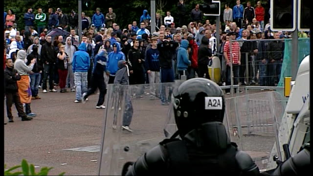56 officers hurt in belfast violence 982013 belfast republican protesters march towards city centre loyalist counterdemonstrators gathered in city... - northern ireland stock videos & royalty-free footage