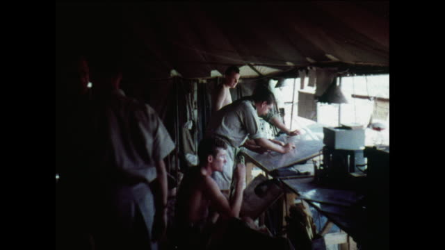 montage officers in headquarters analyze artillery placements / aden, yemen - aden stock videos & royalty-free footage