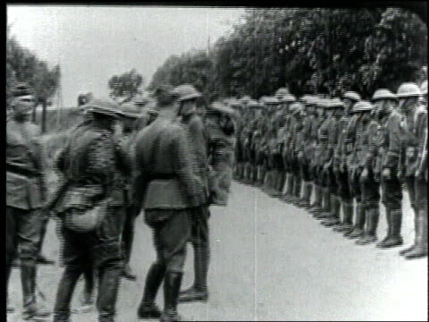 officers inspect wwi soldiers standing at attention / france - 1918 stock videos and b-roll footage