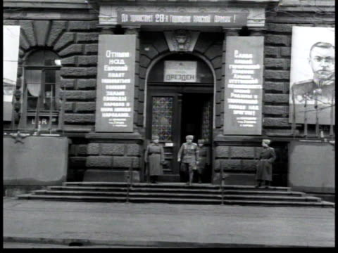 officers leaving headquarters in east berlin, poster of joseph stalin to one side / germany - postwar stock videos & royalty-free footage