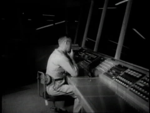 1950 montage officers monitoring security feeds in control center / minneapolis, minnesota, united states - security equipment stock videos & royalty-free footage
