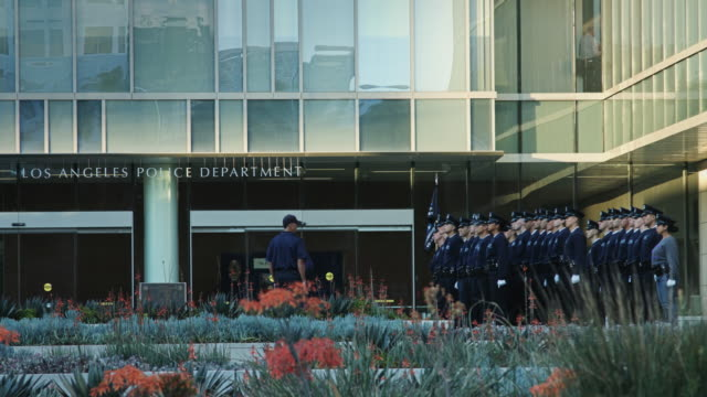 lapd officers on parade outside hq - los angeles police department stock videos & royalty-free footage