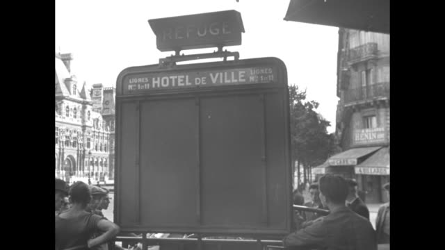 officers or police with rifles aimed out window pan to empty street seen through window / pan from metro station entrance signs reading hotel de... - hotel de ville paris stock videos & royalty-free footage