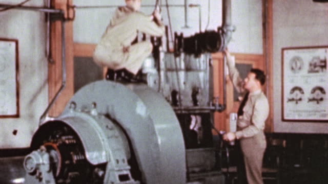 Officers teaching trainees about engineering equipment in school laboratories at the Maritime Service Officers' School / Alameda California United...