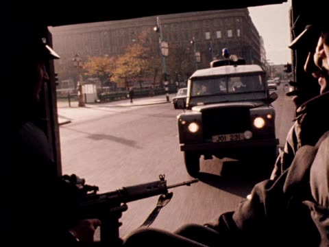 officers travel in a police landrover through the streets of belfast. - land rover stock videos & royalty-free footage