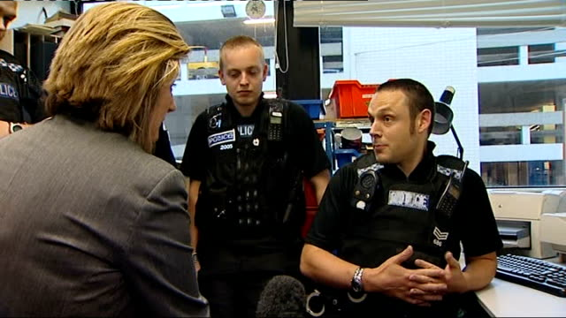 officers vote to lobby for right to strike; cambridgeshire: cambridge: int police officer interviewed sot shots of police officers at work in office... - waist stock videos & royalty-free footage