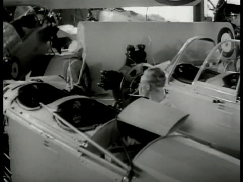 officers walking in airplane factory mechanics incomplete planes. men carrying wing. men laying covering on wing frame. men working inside fuselage.... - allied forces stock videos & royalty-free footage