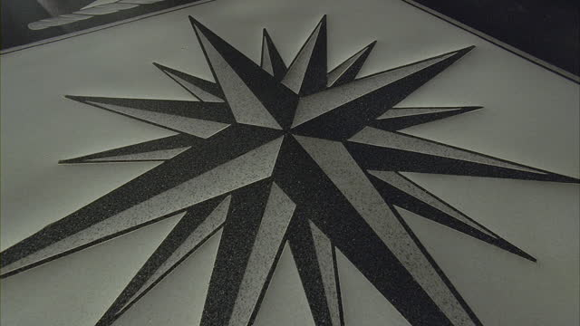 officers walking over the seal of the cia in the lobby of the cia headquarters. - seals stock videos and b-roll footage