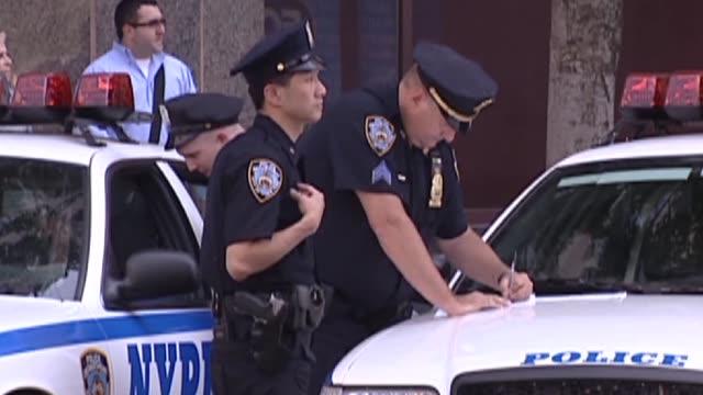 vídeos de stock, filmes e b-roll de officers writing up a ticket - ticket