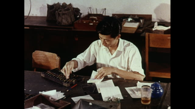 stockvideo's en b-roll-footage met montage offices of hong kong fish market - 1963