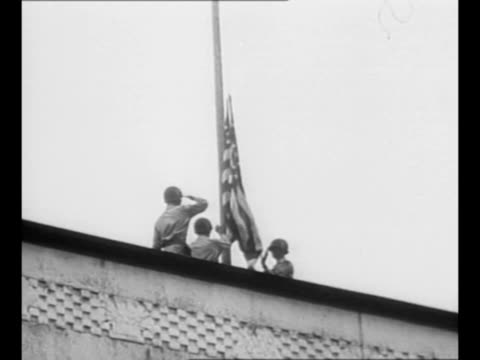 official cars arrive for flagraising ceremony at the us embassy as american forces take over military occupation of japan after world war ii / ws... - douglas macarthur stock videos and b-roll footage