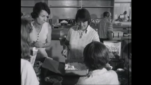 vídeos de stock, filmes e b-roll de official interviews cyclone tracy evacuee with paperwork / salvation army cafeteria / jungle jacks breakfast cereal poured for young boy / salvation... - ovo mexido