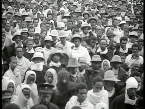official reading paper to crowd ethiopian people gathered in street people standing near railroad car at train station people walking outside from... - 1935 stock videos & royalty-free footage