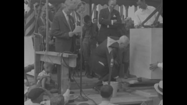 official standing at podium on stage behind cornerstone / official at podium speaking / another official uses trowel to place mortar under... - 1910 stock videos & royalty-free footage