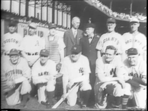 official war bonds jubilee at the polo grounds / crowds seated looking down on baseball field where players are beginning to walk out / more crowd... - former stock videos & royalty-free footage