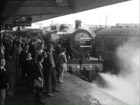 ms officially photograph taking by photographer ,excited children looking at new train / midlands, england - 1959 stock videos & royalty-free footage