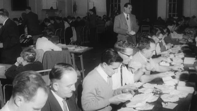 1960 b/w officials counting ballots / united kingdom - voting ballot stock videos and b-roll footage