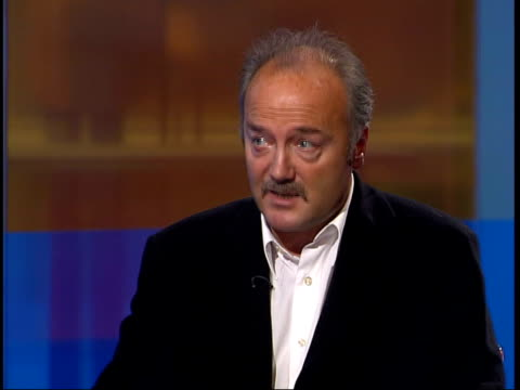 officials deny hiding weapons of mass destruction; itn england: london: gir: int george galloway mp interviewed sot - think is stable, rational,... - weapons of mass destruction stock videos & royalty-free footage