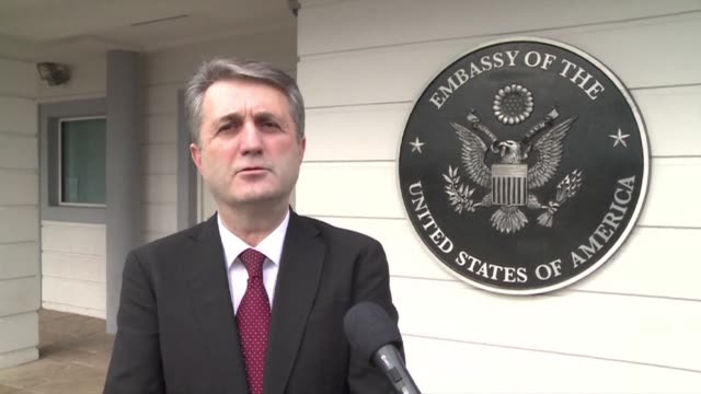 officials in montenegro give details of an attacker who threw a grenade into the us embassy compound in podgorica before blowing himself up causing... - compounding stock videos and b-roll footage