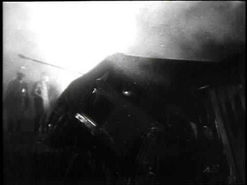 officials inspect train wreckage / smoking train wreckage - skakig kamerabild bildbanksvideor och videomaterial från bakom kulisserna