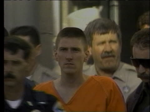 officials lead suspected terrorist timothy mcveigh away from a courthouse. - oklahoma city bombing stock videos & royalty-free footage