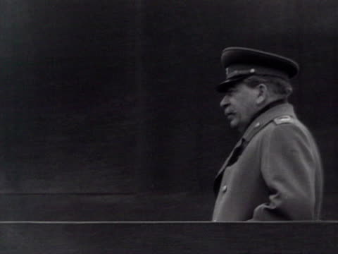 officials moving and saluting audio / moscow, russia - anno 1952 video stock e b–roll